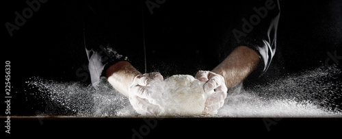 Poster Bakkerij Cloud of flour caused by chef slamming dough