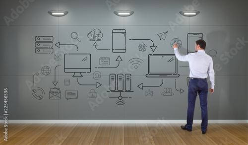 Staande foto Hoogte schaal Businessman drawing tech devices and icons thin line interface on a wall
