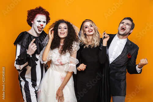 Fotografía Group of laughing friends dressed in scary costumes