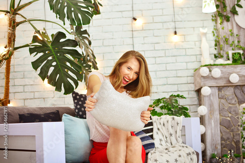 Fotografie, Obraz  Beautiful attractive slim woman in a playful mood at home interior
