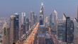Scenic Dubai downtown skyline day to night timelapse. Rooftop view of Sheikh Zayed road with numerous illuminated towers.