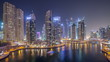 Water canal on Dubai Marina skyline at night timelapse.
