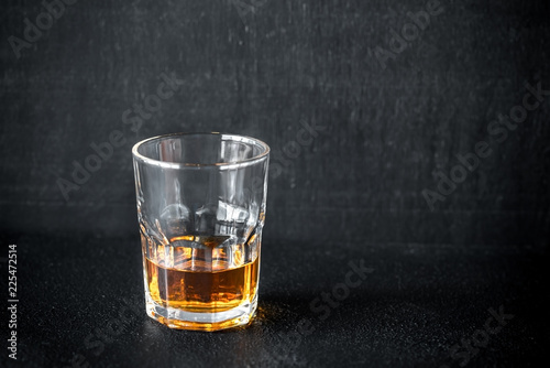Staande foto Alcohol Glass of rum on the dark background