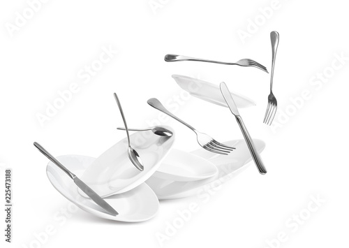 Fototapeta Fall of dishes and cutlery isolated on white background obraz