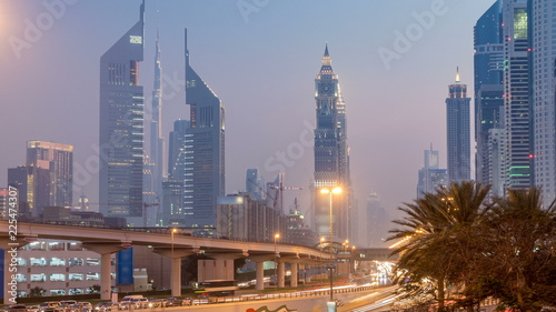 Fotobehang Midden Oosten Traffic on intersection and bridge at the Sheikh Zayed Road day to night timelapse