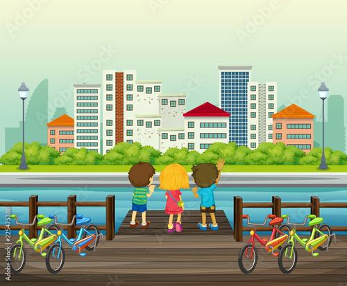 Fotobehang Kids Children rent the bicycle in the park