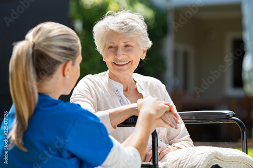 Nurse takes care of old patient