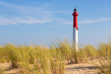 Tall Lighthouse In The Dunes