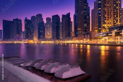 Beautiful view to Dubai Marina Promenade, UAE. Long exposure time lapse effect in the dusk