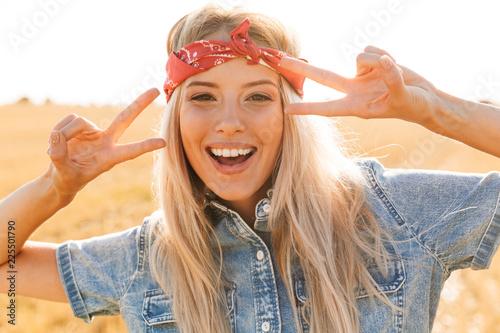 Beautiful young blonde girl in headband Poster Mural XXL