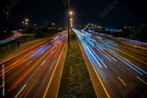 Speed Traffic - light trails on motorway highway at night, long exposure