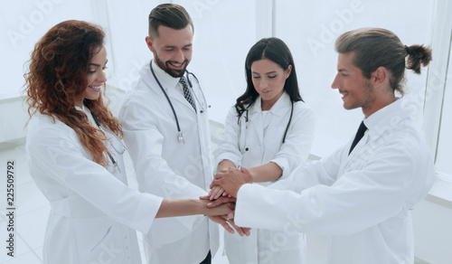 Staande foto Hoogte schaal medical team with hands clasped together