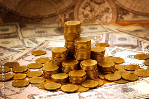 Fotografie, Tablou  Capitalism concept : Coin stack on bank note and vintage map background