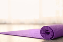 Purple Yoga Mat On Floor Indoors
