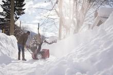 Man Using Snow Blower Machine ...