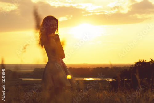 Recess Fitting Zen silhouette of a dreamy girl in a field at sunset, a young woman enjoying nature