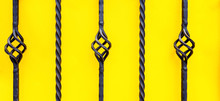 Wrought Iron Fence On Yellow B...