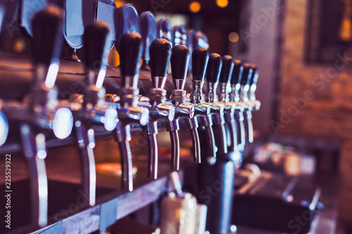 Tuinposter Bier / Cider Beer taps in beer bar