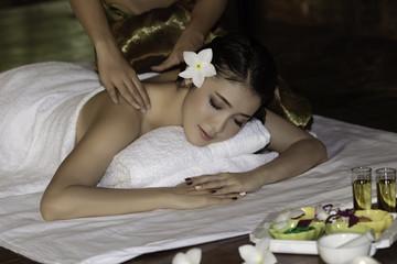Obraz na płótnie Canvas Spa and Massage. Spa body massage treatment. Woman having massage in the spa salon.