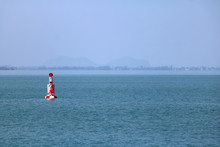 Red Buoy Navigation Or Lateral Marks Floating In The Sea