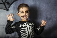 Little Kid In A Skeleton Costu...