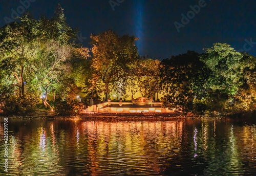 Photo Stands United States The heart of old Hanoi, Lake at night illuminated by lights with a bright reflection in the water, lake and trees