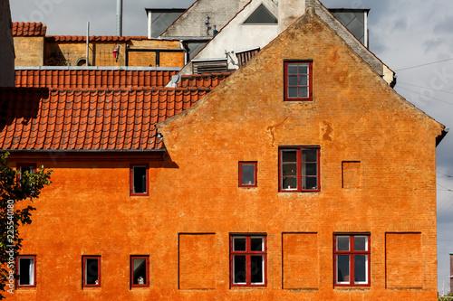 Photo  Orange House wall with windows in Christianshavn Copenhagen Denmark