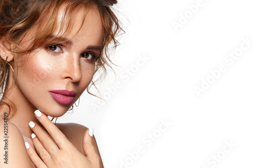 Beautiful woman portrait in romantic style with freckles and curly hair.