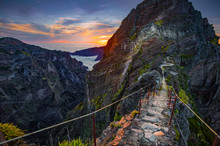 Madeira, Portugal. Hiking Path Between Pico Do Arieiro And Pico Do Ruivo At Sunset Above The Clouds