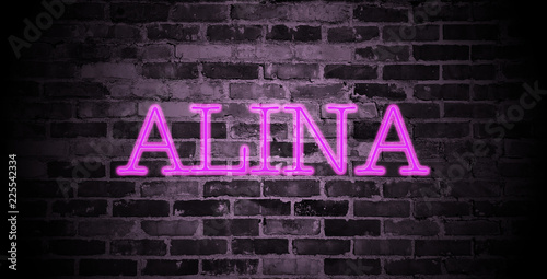 Photo first name Alina in pink neon on brick wall