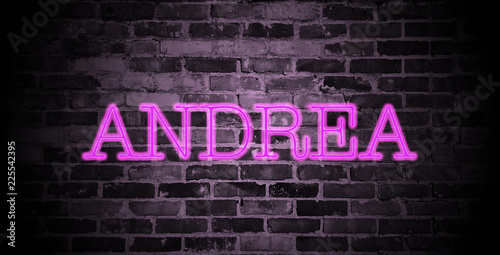 Photo first name Andrea in pink neon on brick wall