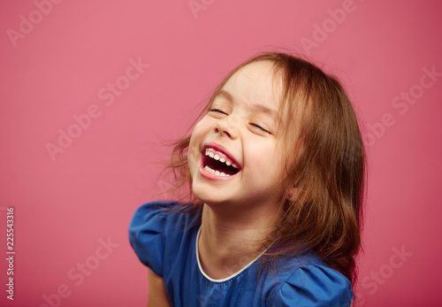 Canvas Print Joyful laughter of children girls with sincere look.