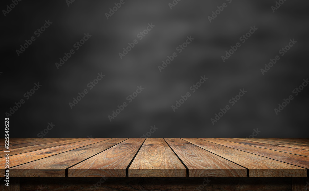 Fototapety, obrazy: Wooden table with dark blurred background.