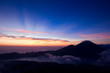 First rays of sunlight on top of Batur volcano in Bali