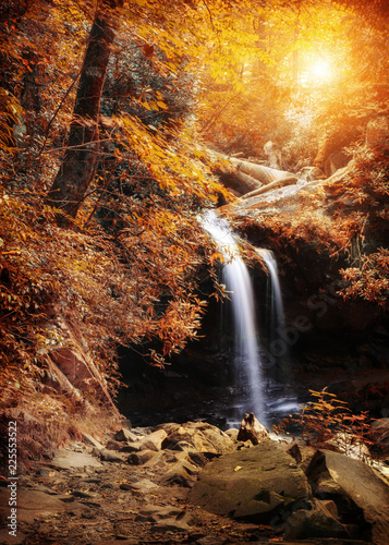 Waterfall in Woods With Autumn Colors Wall mural