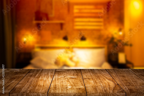 Photo  Wood foreground with blur night bedroom for montage display products background