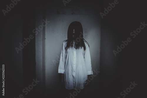 Close up woman wear white shirt in the dark room,Scary movie concept,Horror back Canvas Print