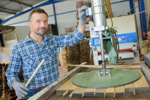 Portrait of man next to woodworking machine