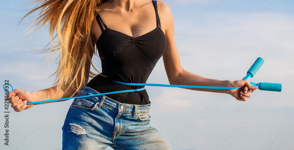 Fototapety, obrazy: Athletic slim woman measuring her waist by measure tape after diet. Slim body, jump rope. Girl with perfect waist with a jump rope in hands. Fit fitness girl measuring her waistline with measure tape.