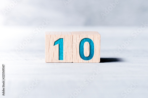 Fotomural Number 10 Formed By Wooden Blocks On A White Table