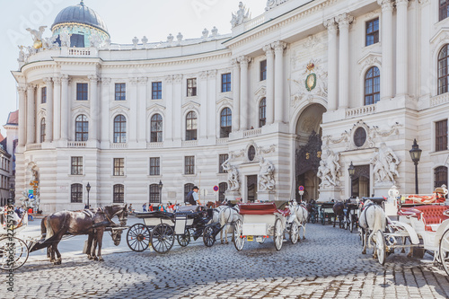 Obraz na plátně Horse drawn carriages hackney coaches standing in front of Hofburg, Imperial Pal