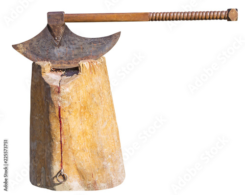 The old rusty ax of the executioner on a wooden stump isolated on white background
