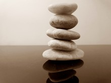 A Stack Of Zen Stones On A Table With Sepia Filter. Concept Of Harmony, Balance And Meditation, Spa, Relax