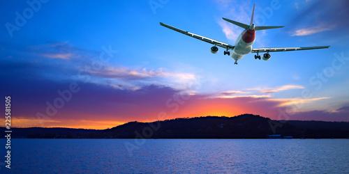 Staande foto Oceanië Jet Airliner Flying in a crimson and blue coloured sunset sky. Queensland, Australia.