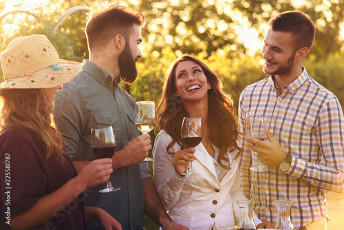 Fotografia, Obraz Happy friends having fun drinking wine at winery vineyard - Friendship concept w