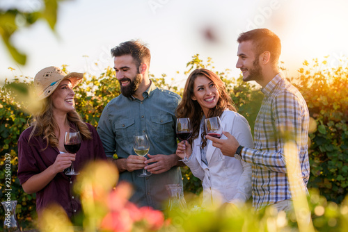 Garden Poster Vineyard Happy friends having fun drinking wine at winery vineyard - Friendship concept with young people enjoying harvest time together