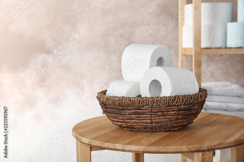 Fotomural Bowl with toilet paper rolls on table indoors. Space for text