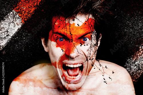 homme visage portrait colère rage sang sanguin peur fou dingue mystique fantastique regard branche arbre silhouette rouge diable incarnation