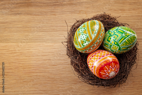Carta da parati Easter holiday and spring celebration concept with three easter eggs decorated w
