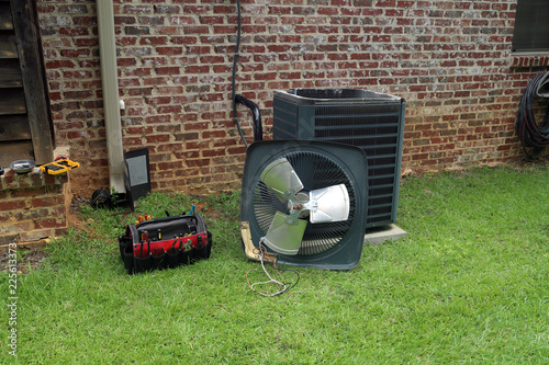 Fotografie, Obraz  Air Conditioner Condenser coil with tools being repaired